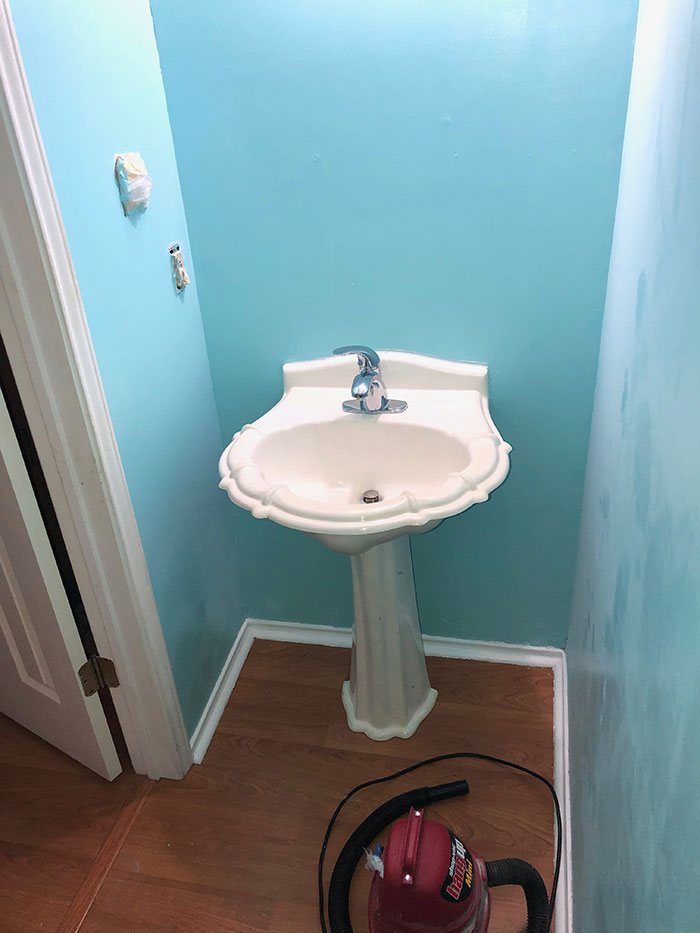 Bathroom-with-wallpaper-removed-and-painted-light-blue